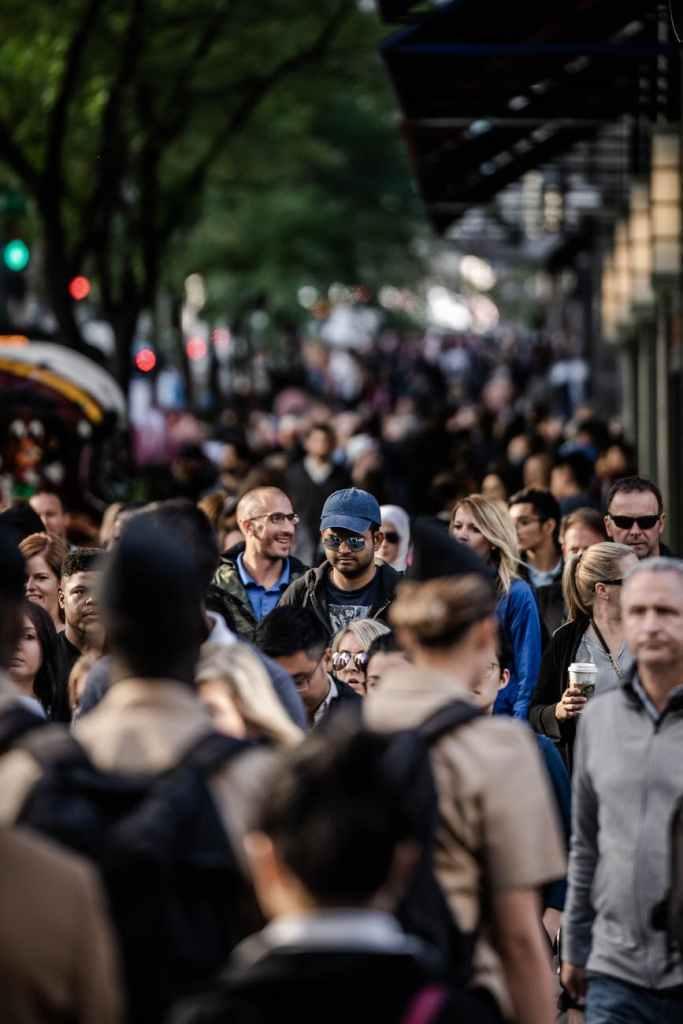 people on sidewalk selective focal photo